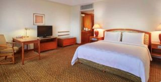 The 36 m² room features a king or twin beds, marble bathroom and dedicated work desk with complimentary high-speed WIFI.